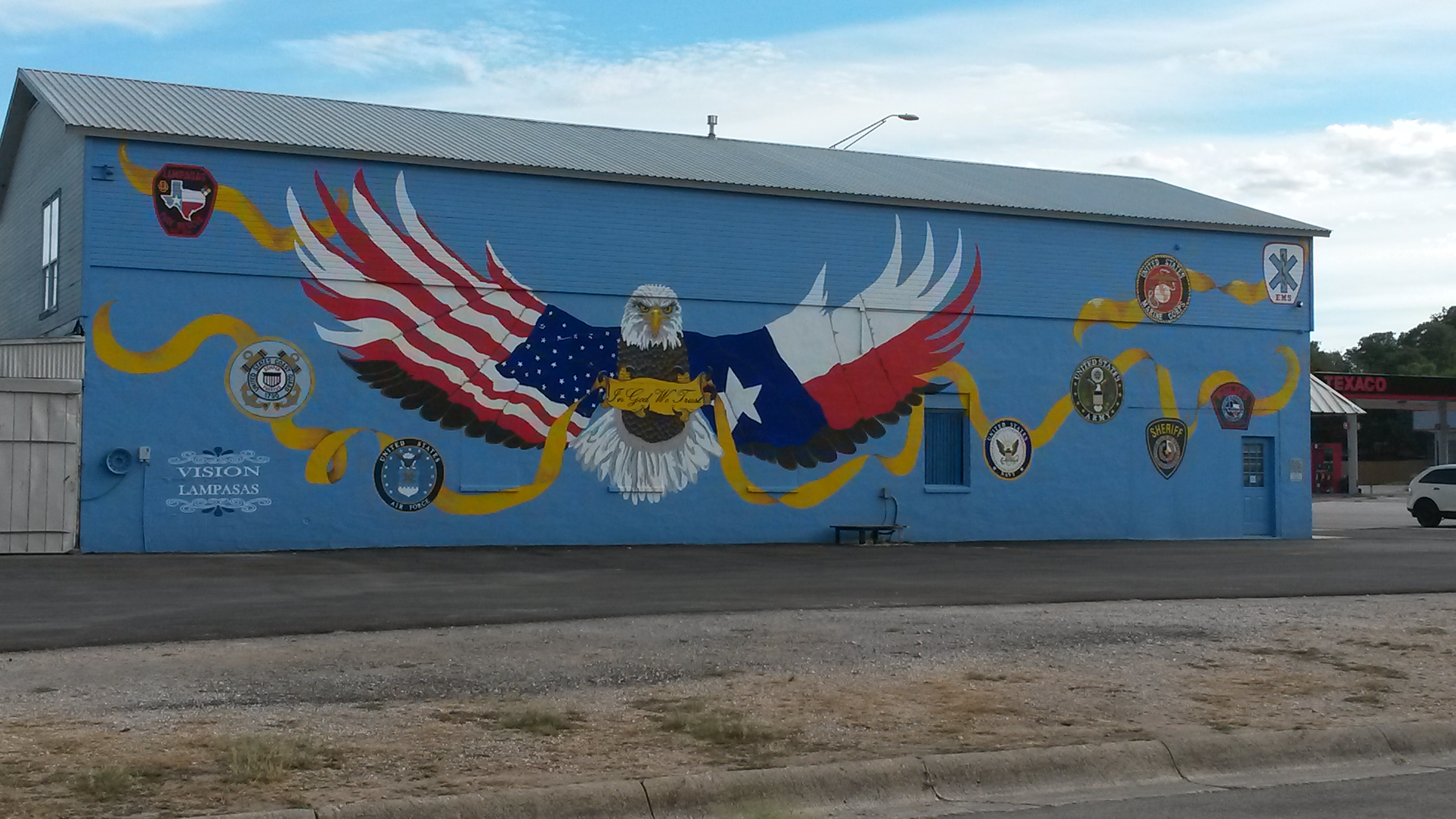 Military-themed painting on building.